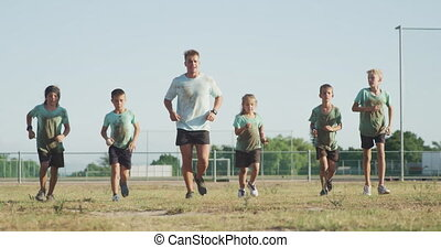 Group of Caucasian children training at boot camp - Front ...
