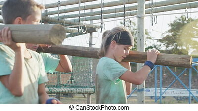 Group of Caucasian children training at boot camp