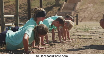 Group of Caucasian children training at boot camp - Side ...