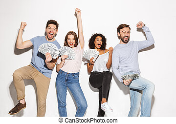 Group of cheerful multiracial people holding money