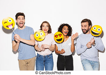 Group of cheerful multiracial people holding smiley faces