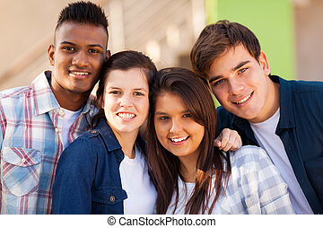 group of cheerful teenage friends closeup portrait outdoors