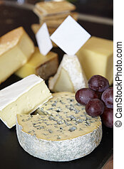 Group of cheese on table