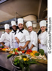 Group of chefs preparing food in kitchen