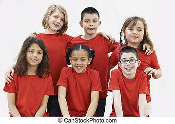Group Of Children Enjoying Drama Workshop Together