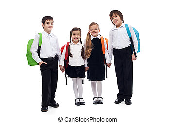 Group of children holding hands going back to school