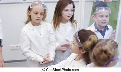 group of children in chemistry at school