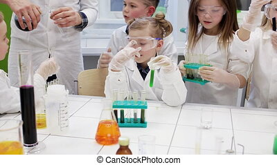 Group of children making science experiments. Education.
