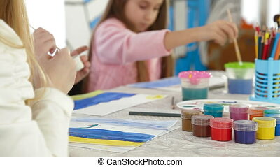 Group of children painting in school