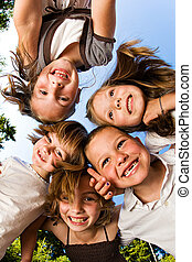 Group of Children - A group of young children huddled up and...