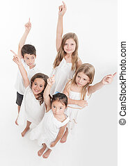 Group of children raising their hands
