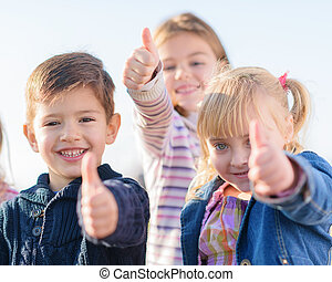 Children Showing Thumb Up Sign
