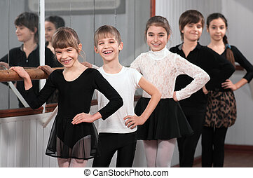 group of children standing at ballet barre - group of funny...