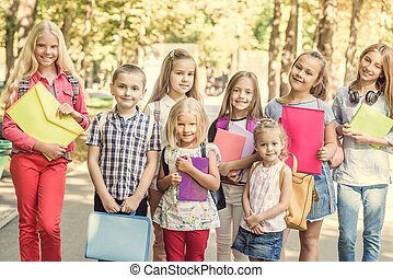 group of children with school backpacks
