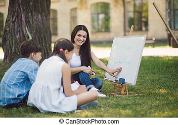 Group of children with teacher in park