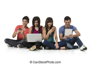 Group of Chinese friends using modern technology.