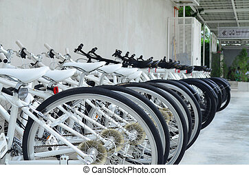 Group of clean and modern bicycle for rent in parking area, healthy and business concept