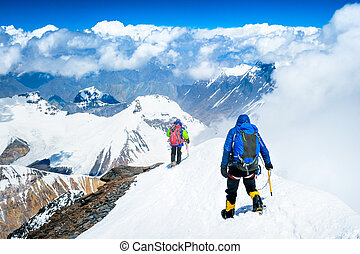 Group of climbers reaching the summit