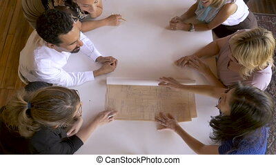 Group of co-workers reveal blueprints for their new startup...