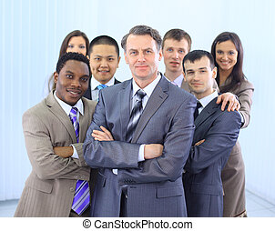 Group of co-workers standing - Group of co-workers standing...