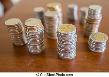 Group of coins, Thai baht on wood table background