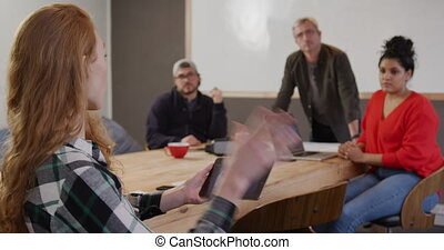 Group of colleagues working in a creative office
