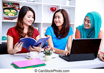 group of college students enjoy studying together