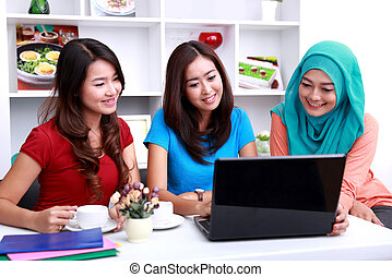 group of college students look happy studying together