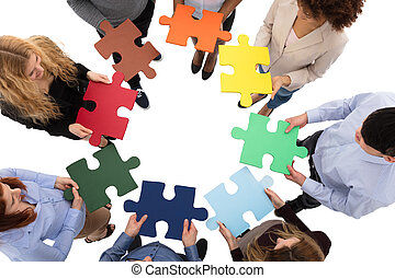 Group Of College Students Solving Puzzle - High Angle View...