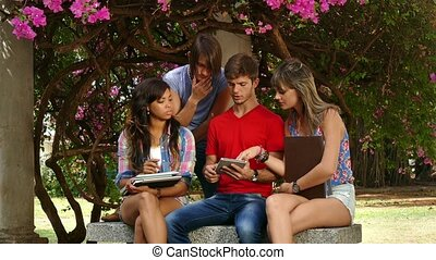 Group Of College Students Talking Studying And Having Fun