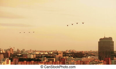 Group of combat helicopters over the city MI-8 red warm...