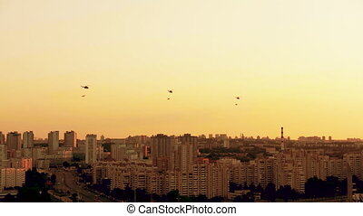 Group of combat helicopters over the city MI-8 with flags on...