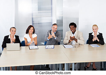 Corporate Personnel Officers Applauding - Group Of Corporate...