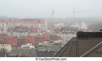 Group of cottages covered by mist with rain. The weather is...