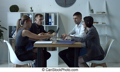 Group of coworkers making great business decisions - Group ...