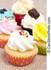 Group of cupcakes with sprinkles. shallow DOF.
