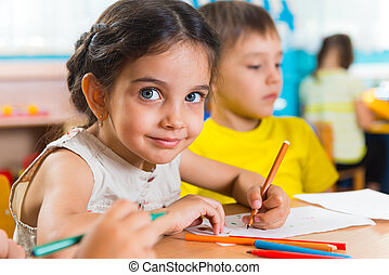 Group of cute little preschool kids drawing with colorful ...