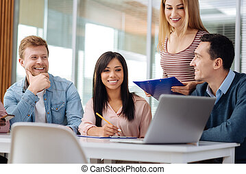 Group of delighted professionals that being in office -...