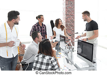 group of designers working in a modern office. photo with ...
