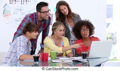 Group of designers working on a lap