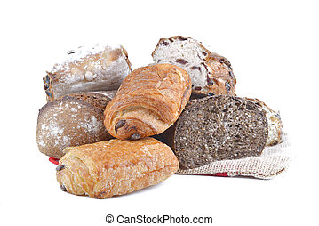 variety of bread and pastry on white background