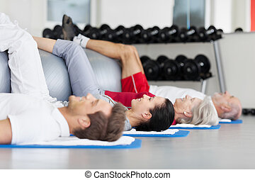 Group of diverse age training at the gym