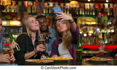 Group of diverse friends taking selfie on mobile phone in ...
