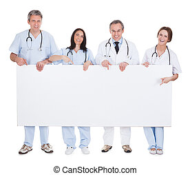 Group Of Doctor Holding Placard