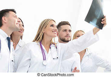 group of doctors discussing an x-ray.concept of health