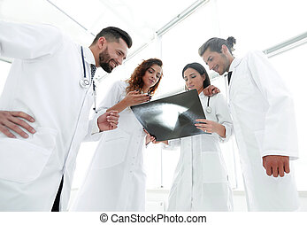 group of doctors discussing an x-ray - closeup of a group of...