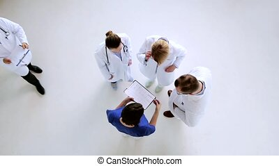 group of doctors discussing cardiogram at hospital