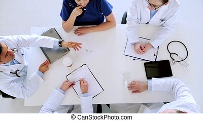 group of doctors discussing cardiogram at hospital -...