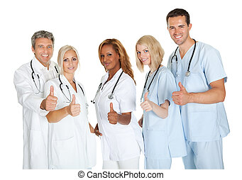 Group of doctors giving thumbs up sign over white