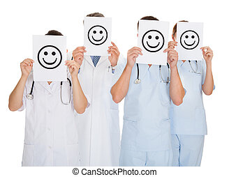 Group Of Doctors Holding Smiley Icon